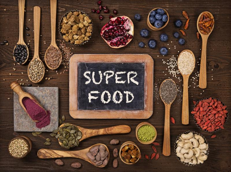 Super foods in spoons and bowls